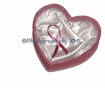 a pink heart with a breast cancer ribbon