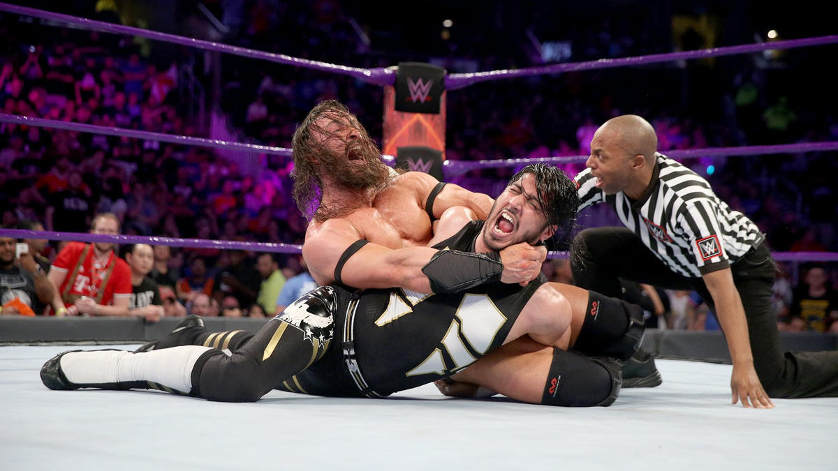 Neville scores the submission victory over Ali.