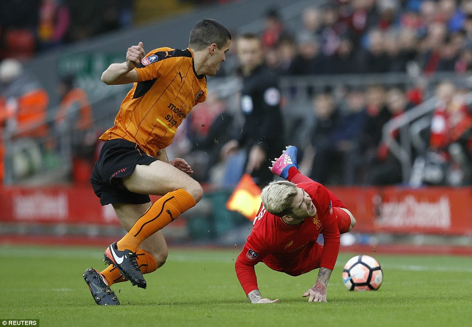 Spanish left back Alberto Moreno takes a tumble under pressure from former Liverpool youngster Conor Coady