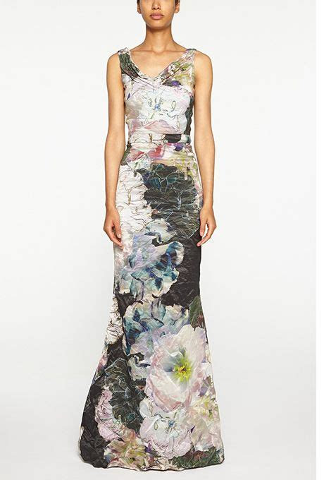 Brides: Nicole Miller. Floral cowl neck mermaid gown, $740