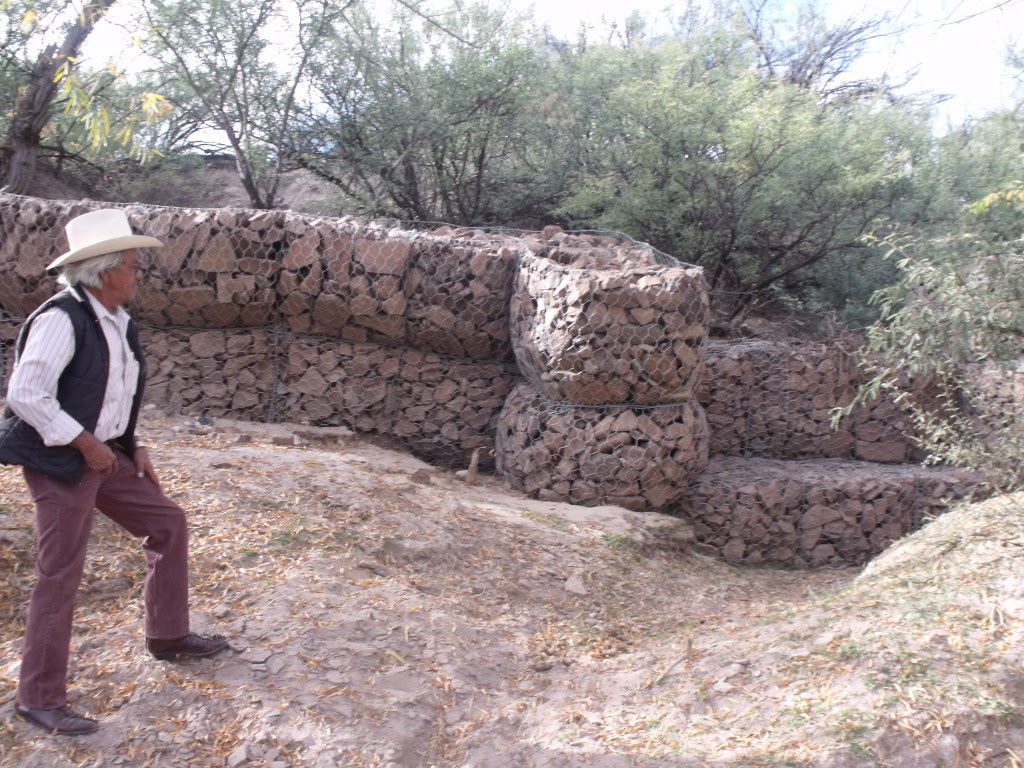 Marcelino Alfaro inspects a newly-constructed gabion.