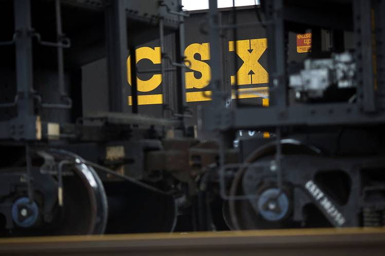 Railroad operator CSX is scaling back some operations in response to declining coal shipments as power plants switch fuels.