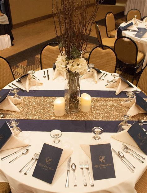 I like the two toned table runners. The centerpiece is too