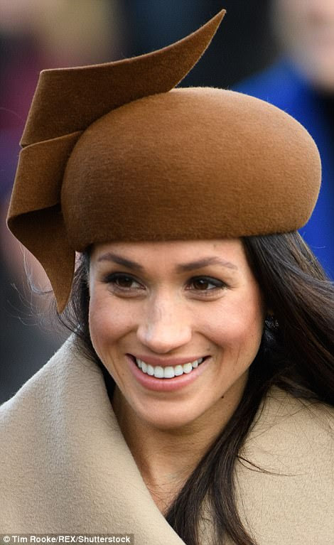 Meghan paired a striking brown beret with a beige coat which she tied up at the front to keep warm in the chilly Christmas Day temperatures