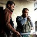 Rebels with the Free Syrian Army prepared to throw a homemade bomb in the northern city of Aleppo on Thursday.