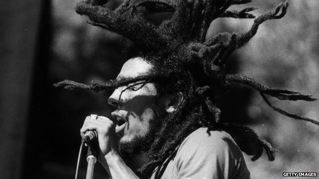 Bob Marley performing on stage