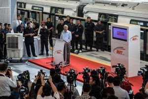 Malaysia's Prime Minister Najib Razak (C) delivers his speach during the phase one launching of the Malaysia Mass Rapid Transit (MYMRT) at the Kwasa Damansara station in Sungai Buloh, on the outskirts of Kuala Lumpur on December 15, 2016. Mass Rapid Transit Corporation Sdn Bhd (MRT Corp) launched its first phase of Malaysia Mass Rapid Transit from Sungai Buloh to Kajang, which runs for 21 kilometres starting at Sungai Buloh Station and ending at Semantan Station. The service will be open to public on December 16. / AFP PHOTO / MOHD RASFAN####################MOHD RASFAN
