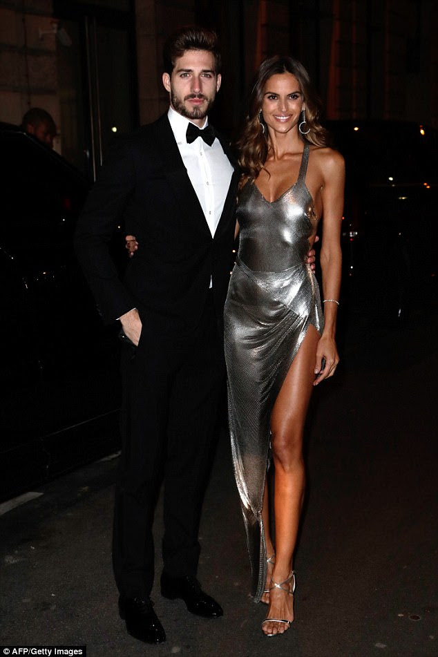 Sensational:Izabel Goulart, 33,  slipped into a figure-hugging silver gown on Sunday as she celebrated footballer Neymar's birthday with boyfriend Kevin Trapp in Paris