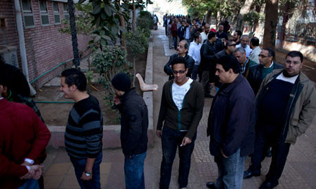 Egyptians line up to vote in the final phase of a national referendum on a draft constitution. The poll has divided the country between secularists, Christians and Islamists. by Pan-African News Wire File Photos