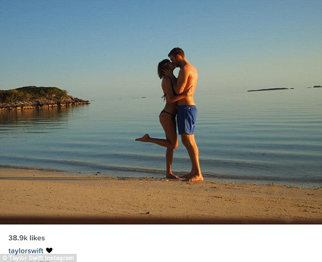 Life's a beach: Taylor Swift and Calvin Harris shared sweet photos from their romantic beach getaway on Tuesday - Taylor captioned this photo with a heart