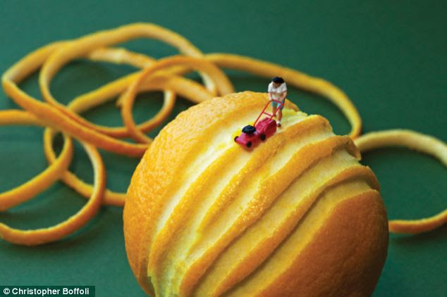Let's hope the lawnmower doesn't run out of juice: This character shows how to peel an orange the hard way