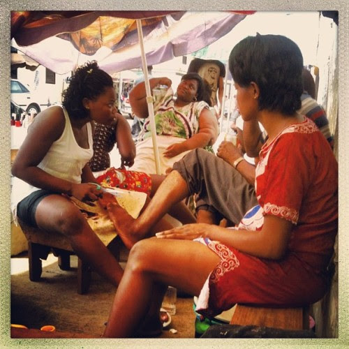 The manicure section of the central market in Malabo, Equatorial Guinea, is busy despite the heat under the umbrellas. Photo by @lindsay_mackenzie #bioko #malabo #equatorialguinea #manicure #pedicure #market #beauty