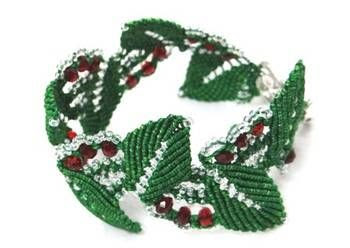 Delicate micromacrame bracelet made one knot at a time with silk threads, embellished with clear czech seed beads and berry red crystals.....Sweet Leaves for your wrist.