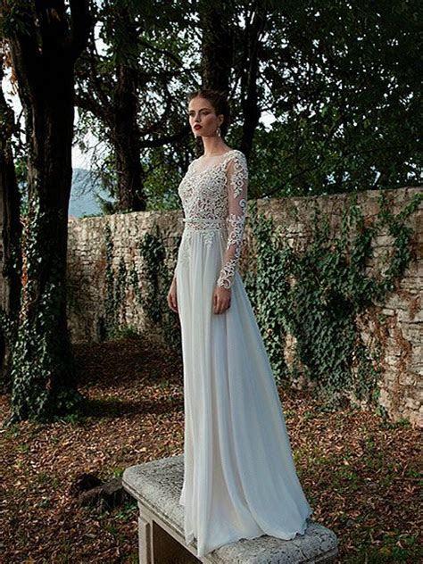 Vestido de novia corte imperio escote ilusión manga larga