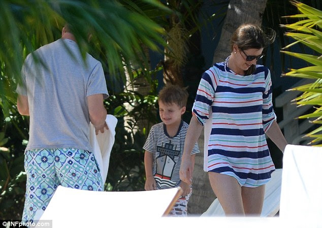 Birthday boy: The sports star will turn 39 on March 24 (seen above with his wife and son)