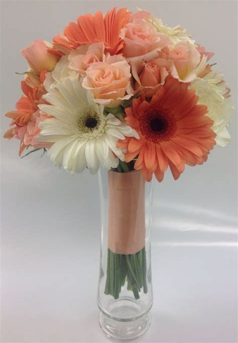 Coral and peach bridesmaid bouquet with gerbera daisies