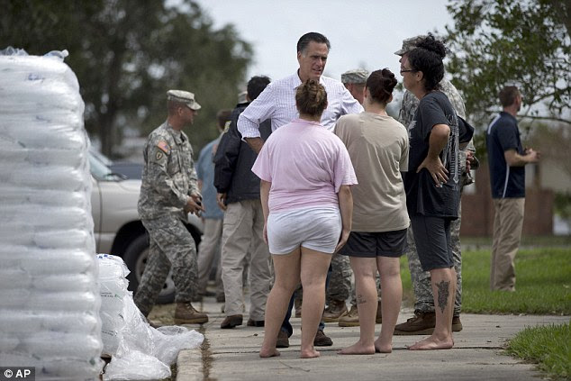 Relief effort: Romney, pictured in LaFittee, centre, has been at the RNC in Tampa, Florida