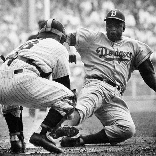 siphotos:<br /><br />Jackie Robinson steals home plate against Yogi Berra during Game 1 of the 1955 World Series on Sept. 28, 1955. The Brooklyn Dodgers lost the game 6-5, but went on to beat the New York Yankees 4-3 in the series. Robinson, the first player to break Major League Baseball's color barrier, was born 95 years ago today. (Mark Kauffman/SI)<br />