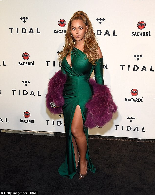 Jewel toned:The Partition artist chose to pull her golden locks up into a half ponytail with glittering eye makeup and pink lips; seen on Tuesday at Barclays Center at the event