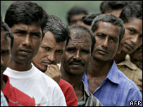 South Asian workers line up at a charity food distribution centre in Kuala Lumpur, Malaysia (27/12/2007)