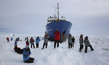Crew on ice outside ship