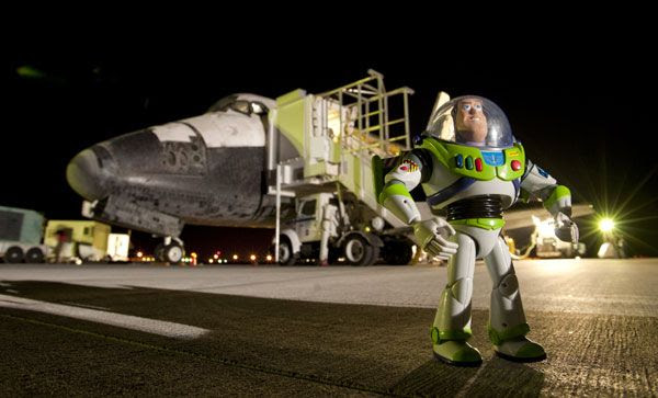 Buzz Lightyear poses proudly in front of the space shuttle Discovery, which took him home on September 11, 2009.