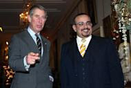 In this photo dated Dec. 9, 2004 Prince Charles, left, greets the Crown Prince of Bahrain, Salman bin Hamad Al Khalifa at St. James Palace, London. The full list of confirmed guests and the seating plan for the royal wedding of Prince William and Kate Middleton were released by the British monarchy Saturday April 23, 2011. St. James's Palace also confirmed for the first time that Bahrain's Crown Prince Salman bin Hamad Al Khalifa will be attending, despite British concerns about the treatment of activists there. Bahrain's royal family ordered a wide-ranging brutal crackdown against pro-democracy demonstrators that started in mid-February. At least 30 people have died, including four in custody, and many well-known activists and lawyers have been imprisoned.  (AP Photo/PA Wire)UNITED KINGDOM OUT