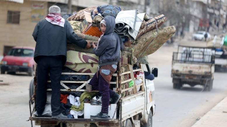 File Photo: Civilians carry their belongings at the recently captured city of Afrin, EPA, AREF TAMMAWI
