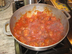cooking the meatballs again in the sauce