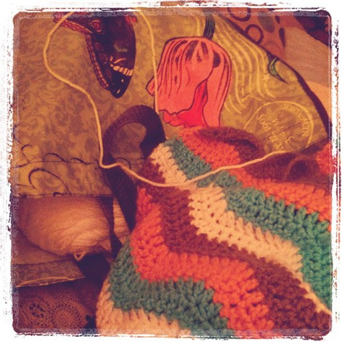 Happiness is a glass of water & crocheting on the couch.