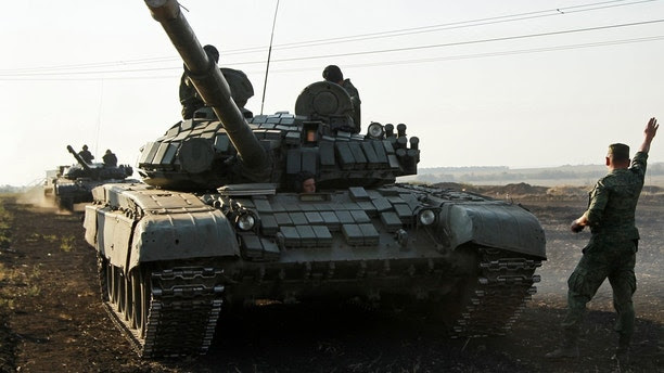 Crew members ride in a T-72 tank during a joint military drills of the self-proclaimed Donetsk People's Republic forces and the Luhansk People's Republics forces at the Torez range outside the rebel-held city of Donetsk, Ukraine September 15, 2017. REUTERS/Alexander Ermochenko - RC1B09361E30