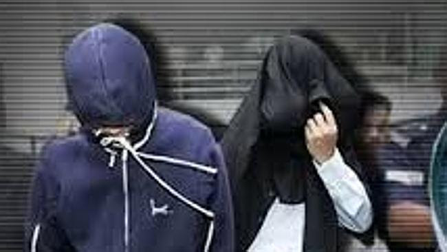 Sirul hides his face after being charged with the murder of Altantuya Shaariibuu in 2006.