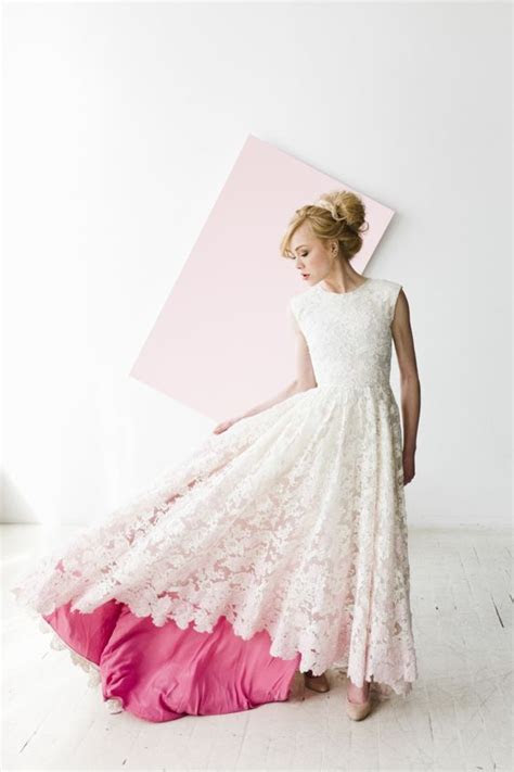 Stunning lace wedding dress with a pink underlay   Wedding