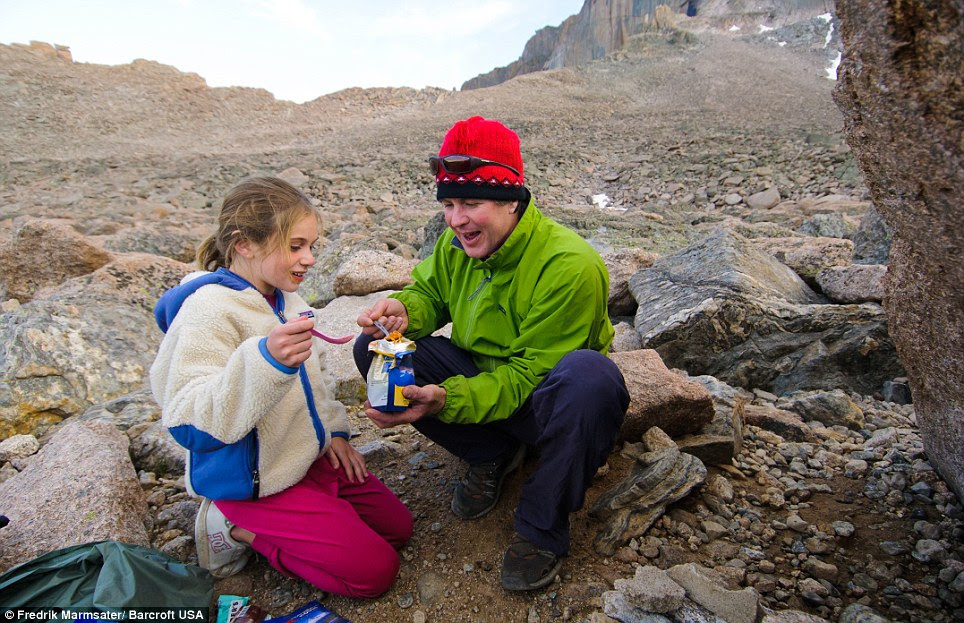 Grub's up: Stella eats pasta and meatballs as she prepares to climb the casual route of the East face of Longs Peak also known as The Diamond with her father in Longs Peak, Colorado