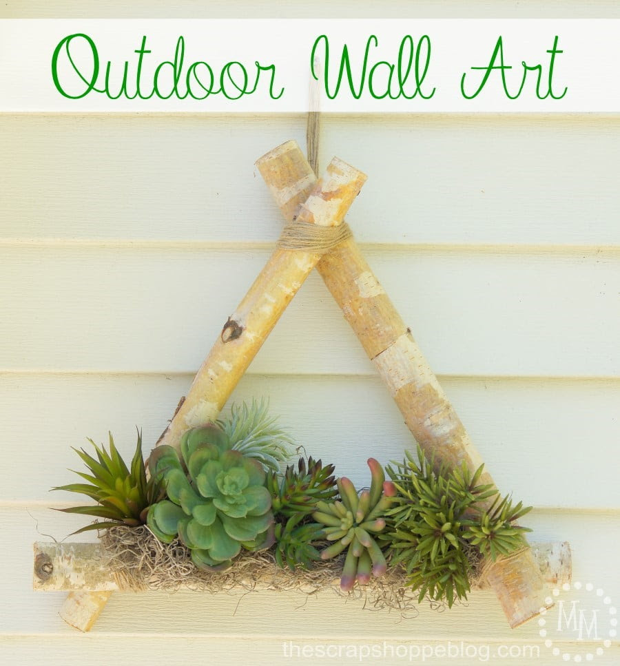 Outdoor wall art with pre-cut birch logs and faux succulents