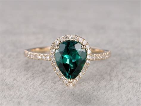 Pear Shaped Emerald Diamond Engagement Ring Yellow Gold