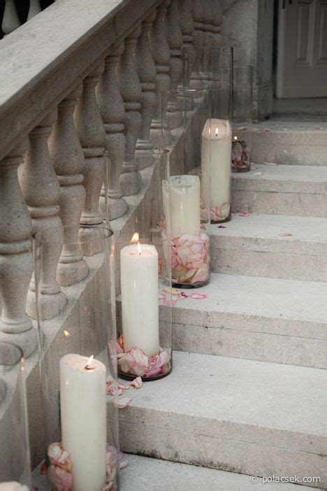 Outside church decorations   pillar candles with rose
