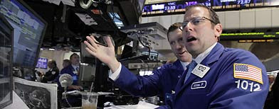 Michael Pistillo, right, works with a fellow specialist on the floor of the New York Stock Exchange Tuesday, Aug. 9, 2011. (AP Photo/Richard Drew)