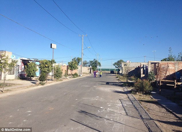 Bad name: Neighbours who claim they witnessed Dafne being beaten by her stepfather in this street said they were glad the family had fled