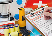 Photo of a person checking items off a emergency preparedness list
