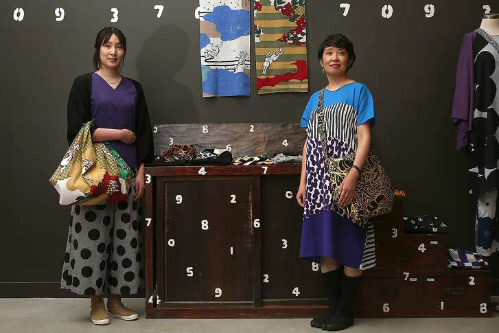 Sales assistant Angie Chen (left) and manager Chinatsu Konobi (right) wear and show Sou Sou products at the New People J-Pop Center in San Francisco, Calif., on Monday, July 13, 2015.