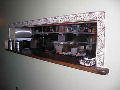 Serving Window at Gustazo Cuban Café is Framed with Spanish Tiles