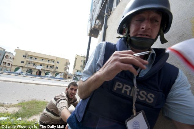 Flashpoint: Andrew Malone and rebel fighter Abu Baker take cover from sniper fire on Tripoli Street