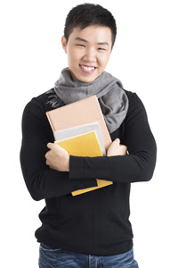 Male student holding books