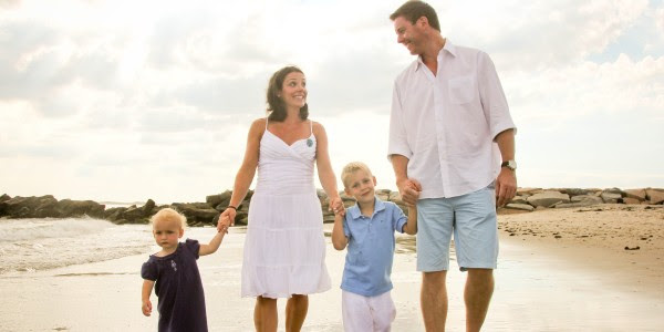 family-walking-on-beach