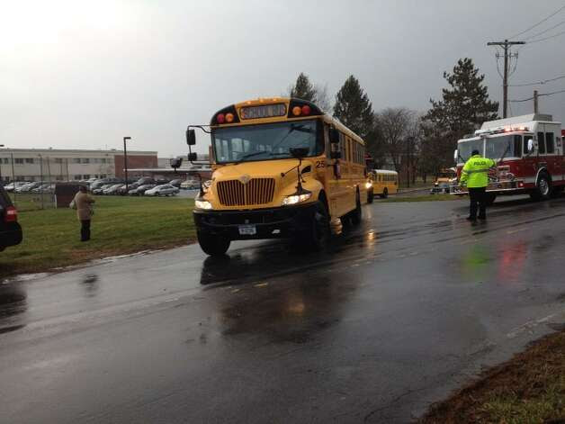 Goff Middle School in East Greenbush is evacuated after wind damage to the building on Friday, Dec. 21, 2012. (John Carl D'Annibale/Times Union) / AL