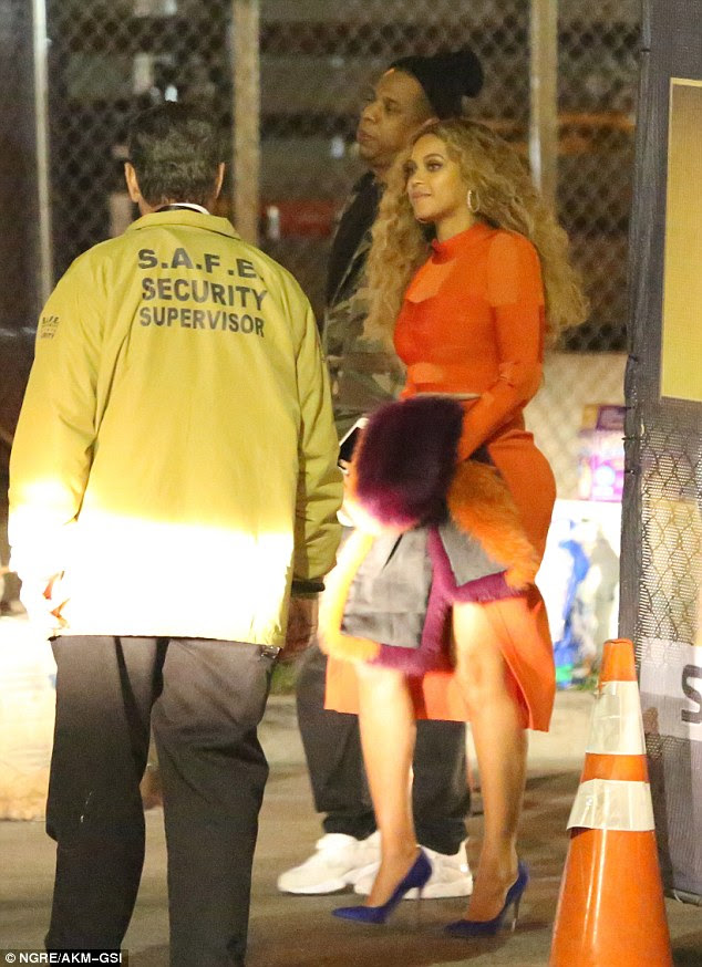Game over: Beyonce and Jay Z were spotted leaving the stadium on Sunday evening