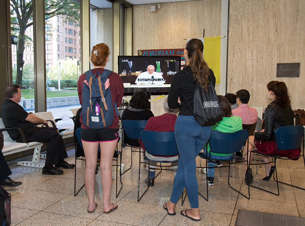Students watch the live stream of the pope's address to the U.S. Congress on Sept. 24. Photo by Patrick Verel