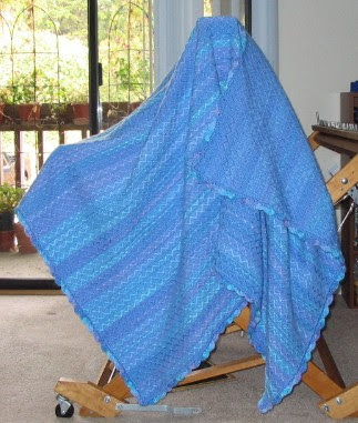 Completed space dyed yarn afghan.