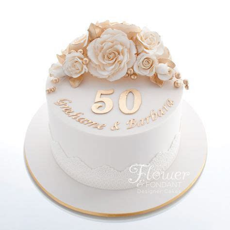 Single tier ivory & gold 50th Anniversary cake. Adorned